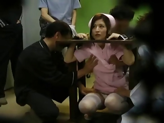 japanese girl is satisfied while being imprisoned in stocks